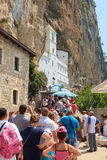 DANILOVGRAD, MONTENEGRO - AUGUST 8, 2014: Many people stand in line to get to the church at the Ostrog monastery Royalty Free Stock Images