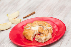 Danish Baked Pastry With Cinnamon Stick and Apple Stock Photo
