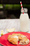 Danish Baked Pastry With Milk and Cut Apple Royalty Free Stock Photo
