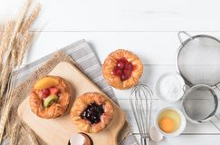 Danish bread with fruits, blueberry and cherry sauce Royalty Free Stock Photos