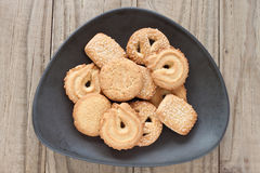 Danish butter biscuits. Danish butter cookies in a brown bowl on a wooden background Stock Image