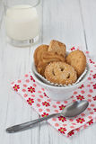 Danish butter biscuits with milk. Danish butter cookies in a white bowl with milk on a white wooden background Stock Photos