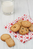 Danish butter biscuits with milk. Danish butter cookies with milk on a white wooden background Stock Photography