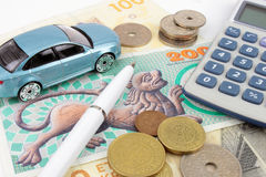 Danish Car Finance. An arrangement of Danish cash and coins with a toy car, calculator and pen to symbolise car finance Stock Photography
