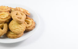 Danish cookies on dish isolated Stock Photos
