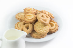 Danish cookies on dish   with milk isolated Royalty Free Stock Images