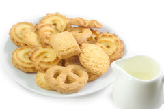Danish Cookies with jug of milk Royalty Free Stock Images