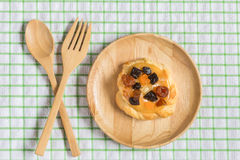 Danish custard with mixed dried fruit on wooden dish Stock Photos