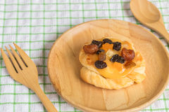 Danish custard with mixed dried fruit on wooden dish Royalty Free Stock Photography