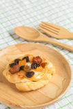 Danish custard with mixed dried fruit on wooden dish Royalty Free Stock Photo