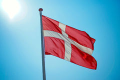 Danish flag. With blue sky in the background Stock Photo