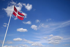 Danish flag. The danish flag and blue and cloudy sky Stock Image