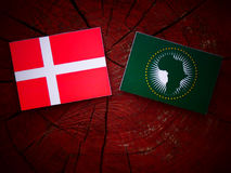Danish flag with African Union flag on a tree stump  Royalty Free Stock Photo