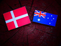 Danish flag with Australian flag on a tree stump isolated. Danish flag with Australian flag on a tree stump Stock Photos