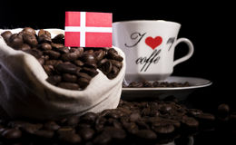 Danish flag in a bag with coffee beans isolated on black Stock Image