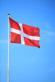 Danish flag with blue sky on background Stock Image
