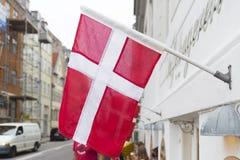 Danish flag on a building. Danish flag in the streets of copenhagen, the danish capital Stock Photo