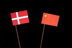 Danish flag with Chinese flag isolated on black. Background Stock Image