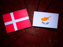 Danish flag with Cypriot flag on a tree stump isolated Stock Images