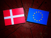 Danish flag with EU flag on a tree stump isolated Stock Photo