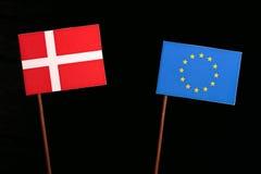 Danish flag with European Union EU flag isolated on black. Background royalty free stock photo