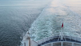 Danish flag fluttering in the wind on the ship stock footage
