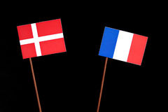 Danish flag with French flag isolated on black Stock Images