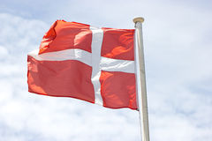 Danish Flag. In Front Of The Sky Stock Image