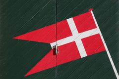 Danish flag. On a green rescue house door Stock Photo