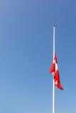 Danish flag at half-mast Stock Photography