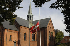 DANISH FLAG AT HALF MST AT SUNBY CHURCH Royalty Free Stock Images