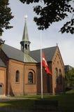 DANISH FLAG AT HALF MST AT SUNBY CHURCH Royalty Free Stock Photo