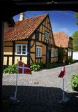 Danish flag and half-timbered house Royalty Free Stock Photos