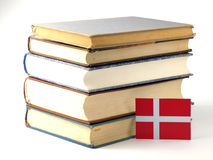 Danish flag with pile of books  on white background. Danish flag with pile of books  on white Stock Photography