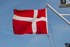 Danish flag on a ship. Danish flag hanging on board a ship Royalty Free Stock Photos