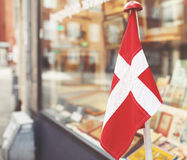 Danish flag in the showcase Royalty Free Stock Photography