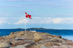 Danish flag. Standing in the sea,landscape Stock Photography