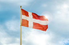 Danish flag. With sun and sky Royalty Free Stock Photos