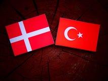 Danish flag with Turkish flag on a tree stump. Danish flag with Turkish flag on a tree stump Royalty Free Stock Photos