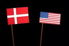 Danish flag with USA flag isolated on black. Background Royalty Free Stock Photos