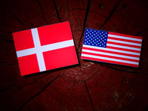 Danish flag with USA flag on a tree stump. Danish flag with USA flag on a tree stump Royalty Free Stock Images