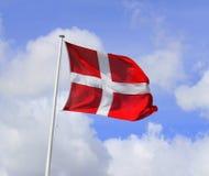 Danish flag. Waving against a blue sky Stock Photo