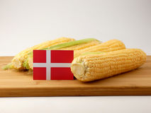 Danish flag on a wooden panel with corn isolated on a white back. Ground Stock Images