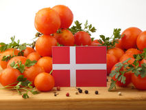Danish flag on a wooden panel with tomatoes isolated on a white Stock Photo