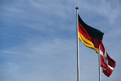 Danish and german flag together Royalty Free Stock Photo