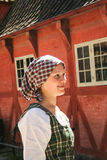 Danish girl  in traditional clothes  at the gamle by of Ahrus. AT AARHUS - ON 07/27/2008   danish girl  in traditional clothes  at the gamle by - old town museum Stock Image