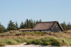 Danish holiday home with thatched roof Stock Photography