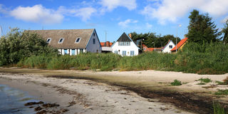Danish  house on coastline in Snogebaek Royalty Free Stock Image