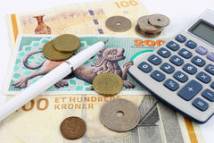 Danish Kroner. Notes and coins arranged with a calculator and pen to symbolise finance Royalty Free Stock Photography