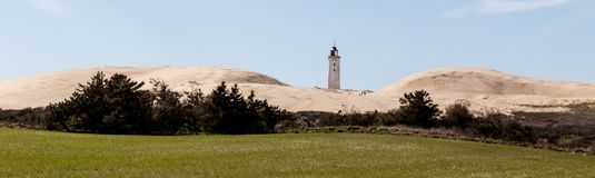 Lighthouse and dunes royalty free stock photo
